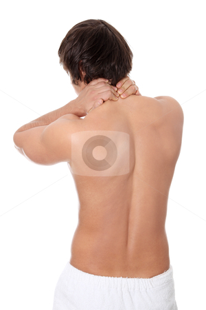 Young man heaving back pain. stock photo, Young man heaving back pain. Isolated on white background  by Piotr_Marcinski