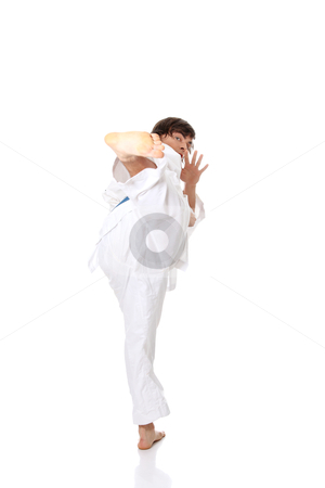 Karate stock photo, Karate. Man in a kimono , isolated on the white background  by Piotr_Marcinski