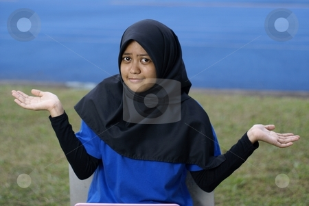 Muslim asian girl with puzzled look stock photo, Muslim asian girl with puzzled blase look by Wong Chee Yen