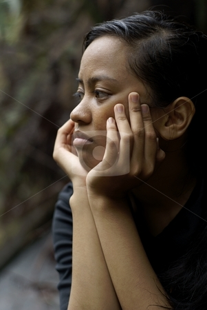 Troubled asian teen gir stock photo, Troubled asian teen girl with hands holding face by Wong Chee Yen