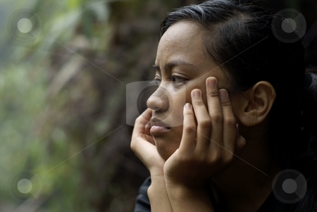 Troubled asian teen girl stock photo, Troubled asian teen girl with hands holding face by Wong Chee Yen