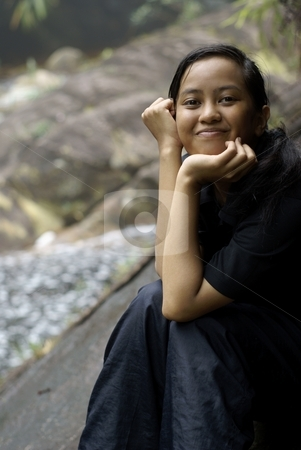 Happy smiling asian malay teen outdoors stock photo, Happy smiling asian malay teen outdoors by Wong Chee Yen