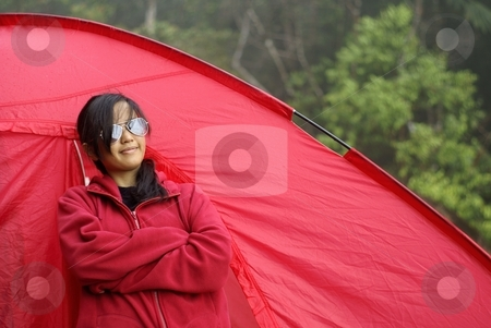 Asian malay teen girl standing beside red tent stock photo, Asian malay teen girl standing beside red tent outdoors by Wong Chee Yen