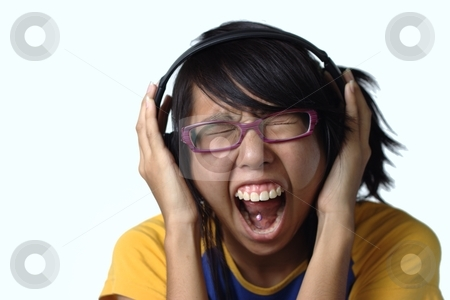 Asian teen lady screaming with headphones stock photo, Asian teen lady ...