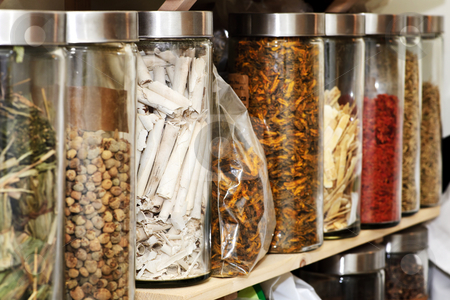 Traditional Chinese herbal medicines stock photo, Traditional chinese medicine herbs and remedies in jars by Elena Elisseeva