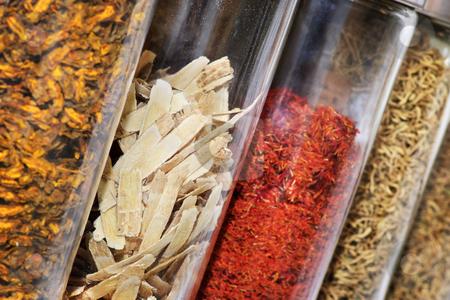 Traditional Chinese herbal medicines stock photo, Traditional chinese medicine herbs and remedies in jars by Elena Elisseeva