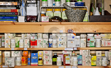 Traditional Chinese medicines stock photo, Various traditional chinese medicine products on shelves by Elena Elisseeva