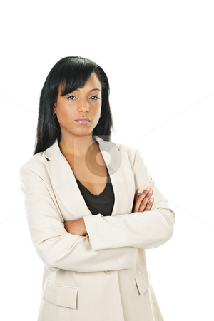 Serious black businesswoman with arms crossed stock photo, Determined black businesswoman with arms crossed isolated on white background by Elena Elisseeva