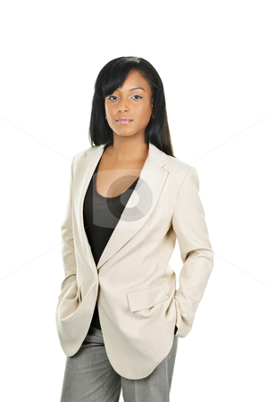 Confident black businesswoman stock photo, Successful black businesswoman standing isolated on white background by Elena Elisseeva