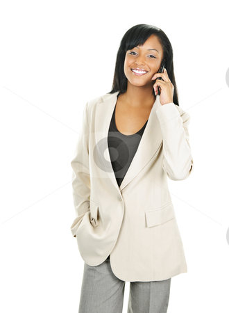 Smiling black businesswoman on phone stock photo, Young happy black businesswoman on cell phone isolated on white background by Elena Elisseeva