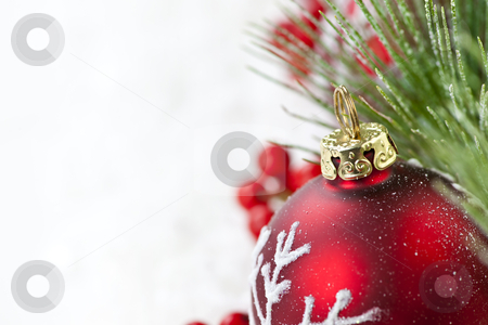Red Christmas ornament border stock photo, Red Christmas decoration with pine needles with copy space by Elena Elisseeva