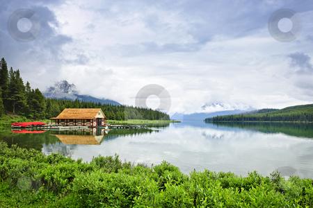 Boathouse on mountain lake stock photo, Canoes at boathouse on Maligne Lake in Jasper National Park, Canada by Elena Elisseeva