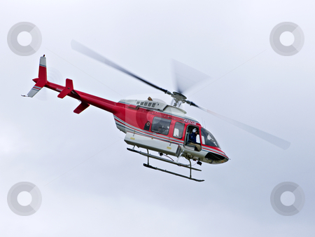 Rescue helicopter stock photo, Red rescue helicopter flying mission in emergency by Elena Elisseeva