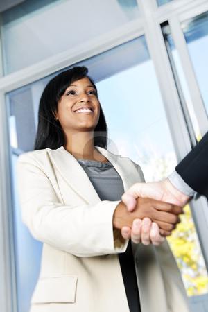 Business woman shaking hands stock photo, Portrait of black business woman shaking hands by Elena Elisseeva