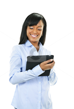 Happy woman with tablet computer stock photo, Young smiling black woman using tablet computer by Elena Elisseeva