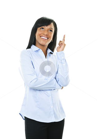 Smiling young woman has idea stock photo, Smiling black woman with idea isolated on white background by Elena Elisseeva