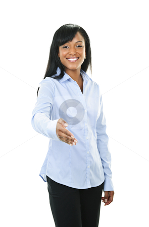 Smiling young woman offering hand stock photo, Smiling black woman offering hand for handshake isolated on white background by Elena Elisseeva