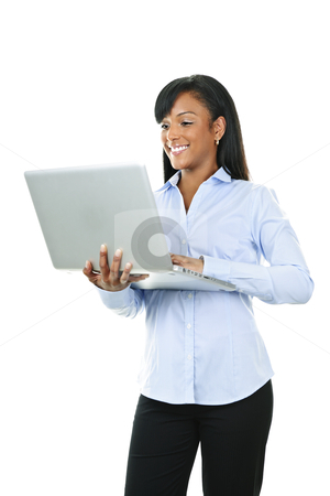 Smiling woman with laptop computer stock photo, Young smiling  black woman standing with laptop computer by Elena Elisseeva