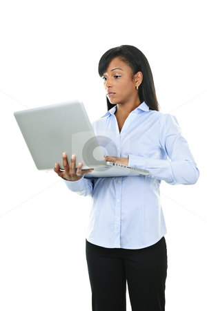Serious woman with laptop computer stock photo, Young serious black woman working with laptop computer by Elena Elisseeva