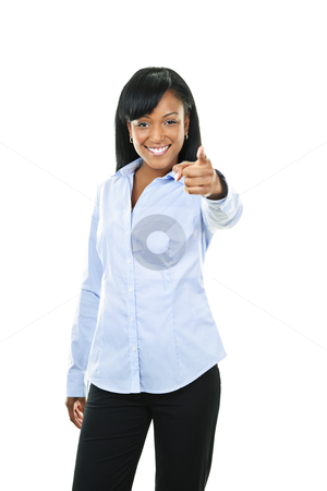 Smiling young woman pointing finger stock photo, Smiling black woman pointing finger at camera isolated on white background by Elena Elisseeva