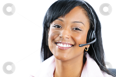 Customer service and support representative with headset stock photo, Smiling black customer service and support woman wearing headset by Elena Elisseeva