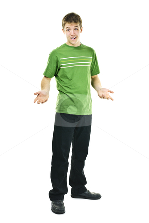 Young man shrugging stock photo, Shrugging young man standing isolated on white background by Elena Elisseeva