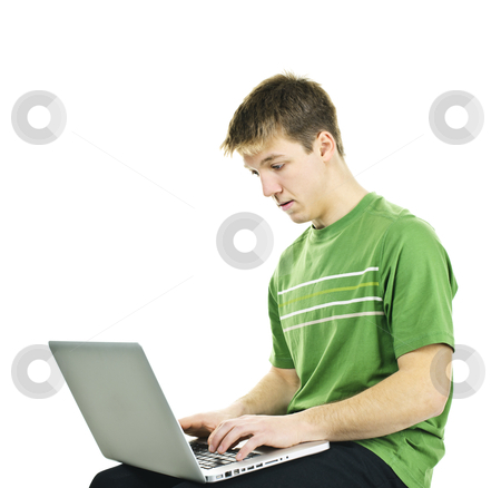 Young man with laptop computer stock photo, Serious young man sitting with laptop computer isolated on white background by Elena Elisseeva