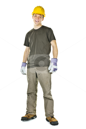 Young construction worker smiling stock photo, Happy construction worker with hard hat full body standing isolated on white background by Elena Elisseeva