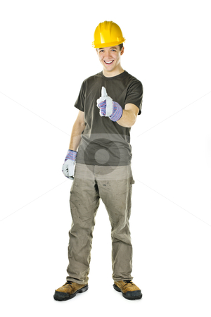 Construction worker showing thumbs up stock photo, Smiling construction worker showing thumbs up isolated on white background by Elena Elisseeva