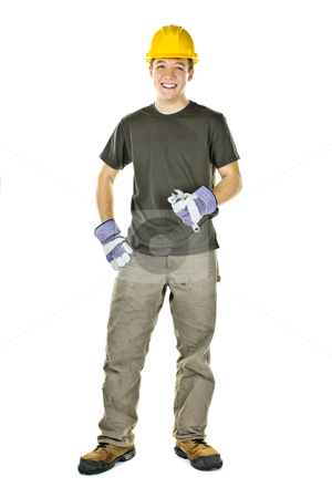Young construction worker smiling stock photo, Smiling construction worker holding wrench isolated on white background by Elena Elisseeva