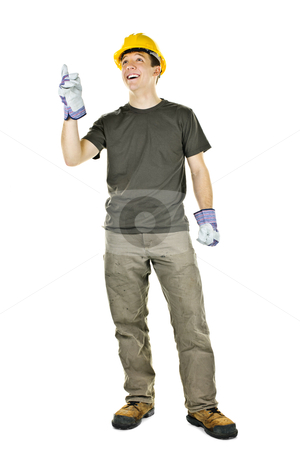 Construction worker pointing up stock photo, Smiling construction worker pointing up standing isolated on white background by Elena Elisseeva