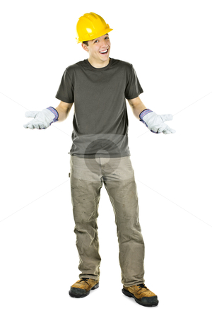 Smiling construction worker shrugging stock photo, Happy construction worker with hard hat shrugging isolated on white background by Elena Elisseeva