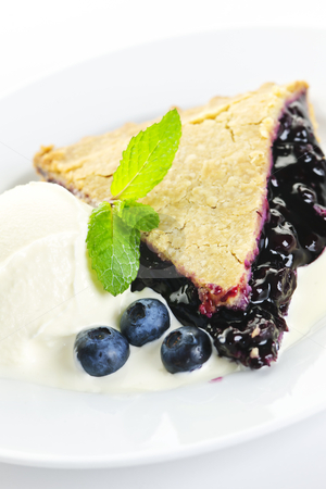 Blueberry pie slice stock photo, Slice of blueberry pie with vanilla ice cream and berries by Elena Elisseeva