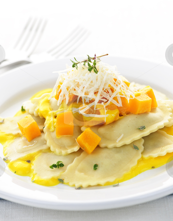 Ravioli dinner stock photo, Gourmet squash ravioli dinner served with cheese on plate by Elena Elisseeva