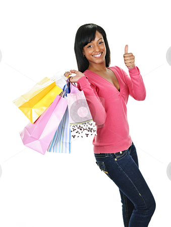 Young happy black woman with shopping bags stock photo, Young smiling black woman with shopping bags giving thumbs up by Elena Elisseeva