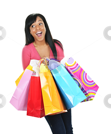 Excited young black woman with shopping bags stock photo, Young happy excited black woman holding shopping bags by Elena Elisseeva