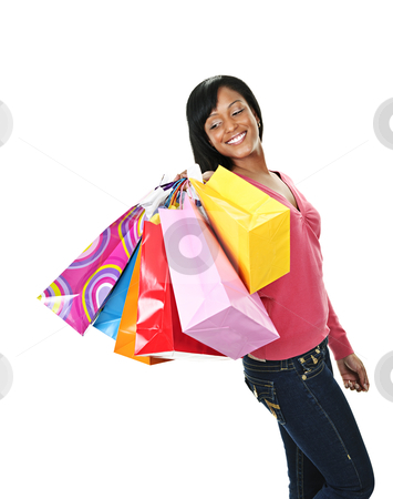 Young smiling black woman with shopping bags stock photo, Young joyful black woman holding shopping bags by Elena Elisseeva