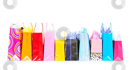 Row of shopping bags stock photo, Row of colorful shopping bags isolated on white background by Elena Elisseeva