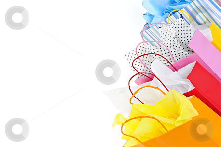 Shopping bags stock photo, Many colorful shopping bags on white background by Elena Elisseeva