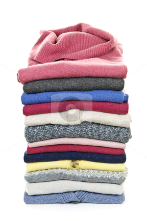Stack of sweaters stock photo, Stack of warm sweaters isolated on white background by Elena Elisseeva