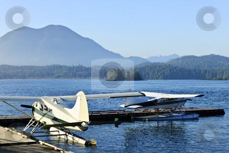 Sea planes at dock in Tofino, Vancouver Island, Canada stock photo, Seaplanes at dock in Tofino on Pacific coast of British Columbia, Canada by Elena Elisseeva