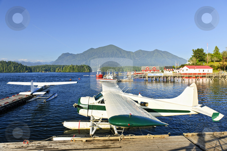 Sea planes at dock in Tofino, Vancouver Island, Canada stock photo, Seaplanes at dock in Tofino on Pacific coast of British Columbia, Canada by Elena Elisseeva