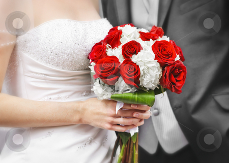 Bride and groom with bridal bouquet stock photo, Bride and groom holding bridal bouquet close up by Elena Elisseeva