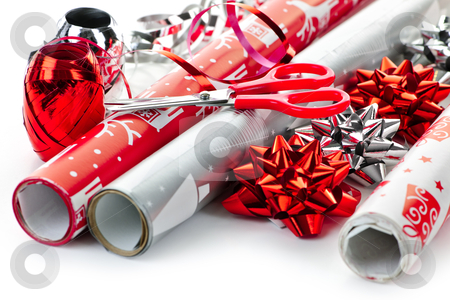 Christmas wrapping paper rolls stock photo, Rolls of Christmas wrapping paper with ribbons, bows and scissors by Elena Elisseeva