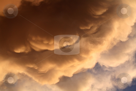 Colorful storm clouds at sunset stock photo, Colorful storm clouds at sunset by Mark Duffy