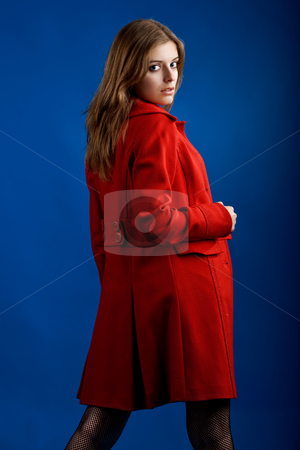 Woman in Red stock photo, Portrait of a beautiful and sexy young model posing with a red jacket by ikostudio