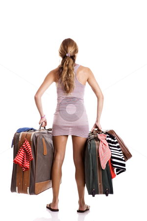 Traveller woman stock photo, Rear view of a beautiful and young woman carying the baggage with clothes by ikostudio