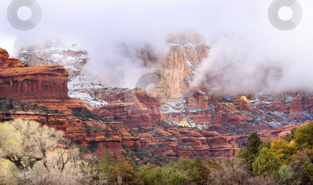 Clouds Over Sedona Boynton Red Rock Canyon Snow Arizona stock photo, Early Morning Boynton Red White Sunshine Rock Canyon Snow Clouds Green Trees Sedona Arizona by William Perry