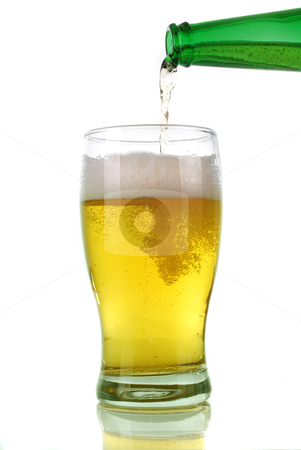 Beer pouring from bottle into glass stock photo, Beer pouring from bottle into glass isolated on white  by bakelyt