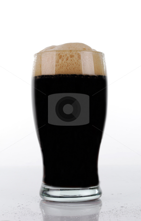 Brown beer glass stock photo, Brown beer glass in white background by bakelyt